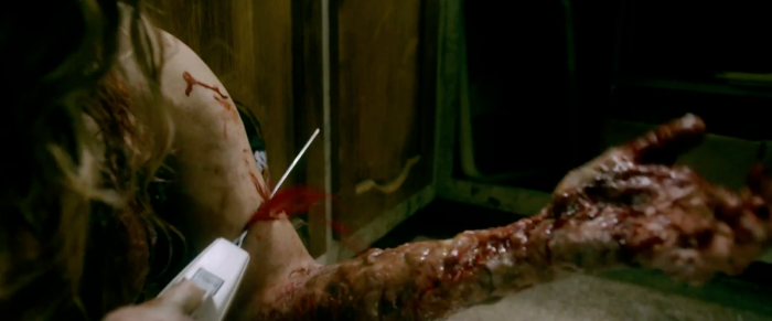 evil-dead-remake-2013-arm-cuttting-scene